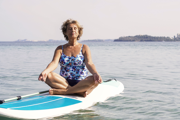 Woman paddleboard yoga
