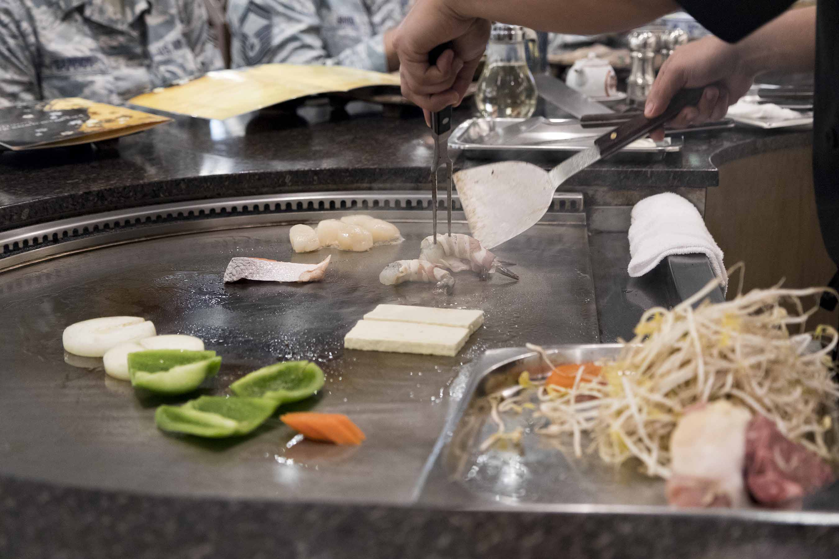 Chef cooking on the grill at a Japanese Steak House