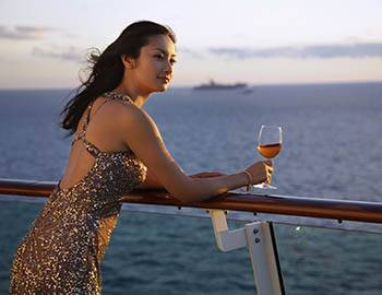 Woman in a sparkly dress on a cruise ship in Maui