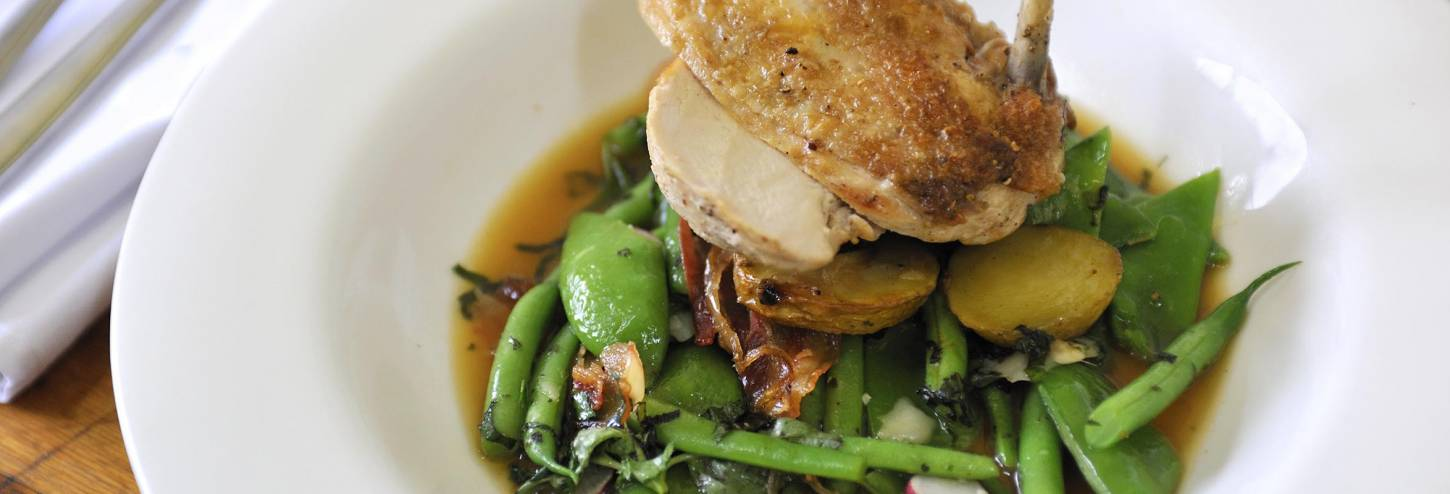 Chicken dish in a sauce with greens