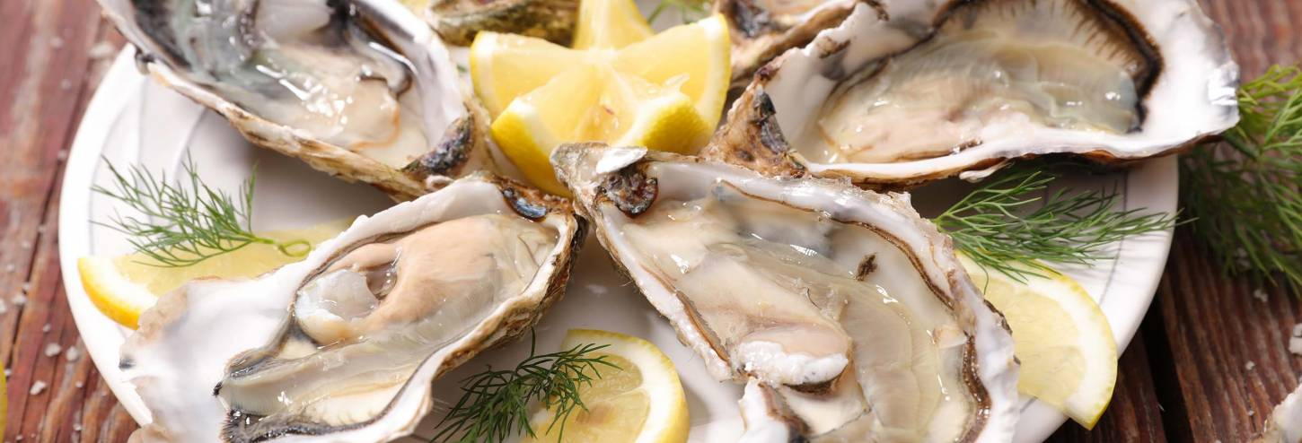 Fresh Oysters on a Plate with Lemon
