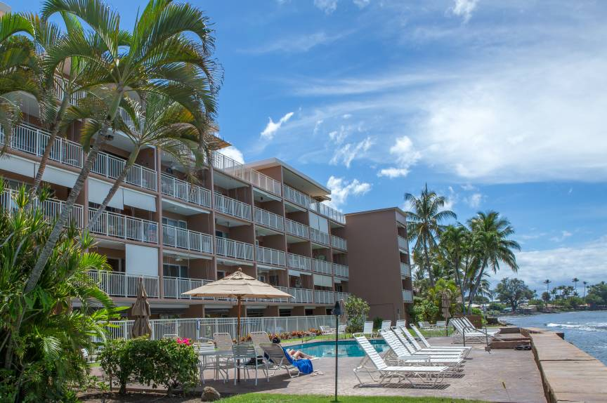 The resort at Lahaina Roads and palm trees