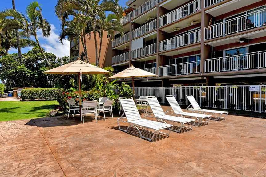 Lounge chairs and umbrellas at Lahaina Roads Resort